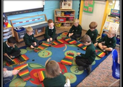 Reception pupils learning the xylophone.